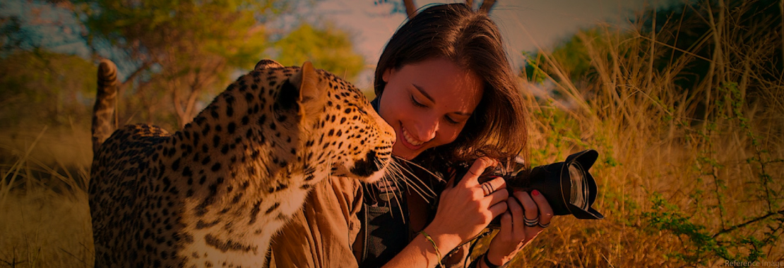 a photographer with a cheetah