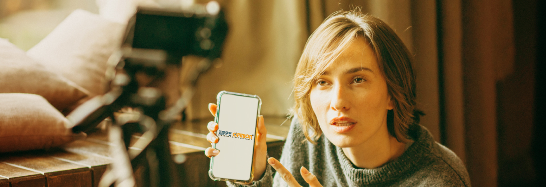 A woman holding up her phone